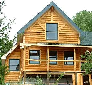 SIP panel cottage with log siding