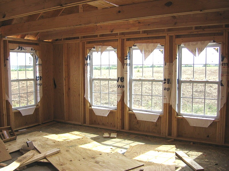 windows framed with Tyvek to inside